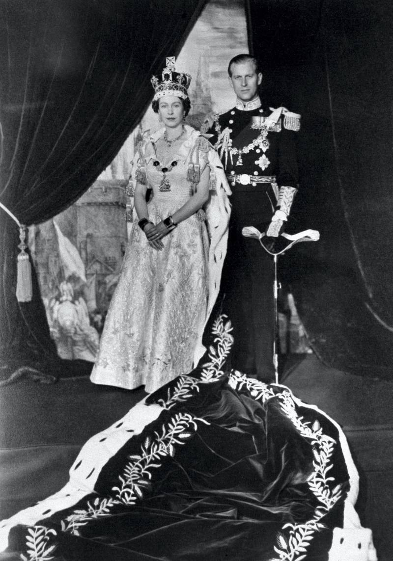 The Queen Elizabeth II and the Prince Philip pose after the Queen's Coronation, 02 June 1953 in Buckingham Palace. (Photo by - / - / AFP)