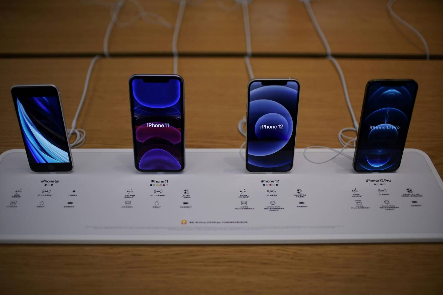 FILE PHOTO: Apple's 5G iPhone 12 and iPhone 11 are seen at an Apple Store, as the coronavirus disease (COVID-19) outbreak continues in Shanghai China October 23, 2020. REUTERS/Aly Song/File Photo