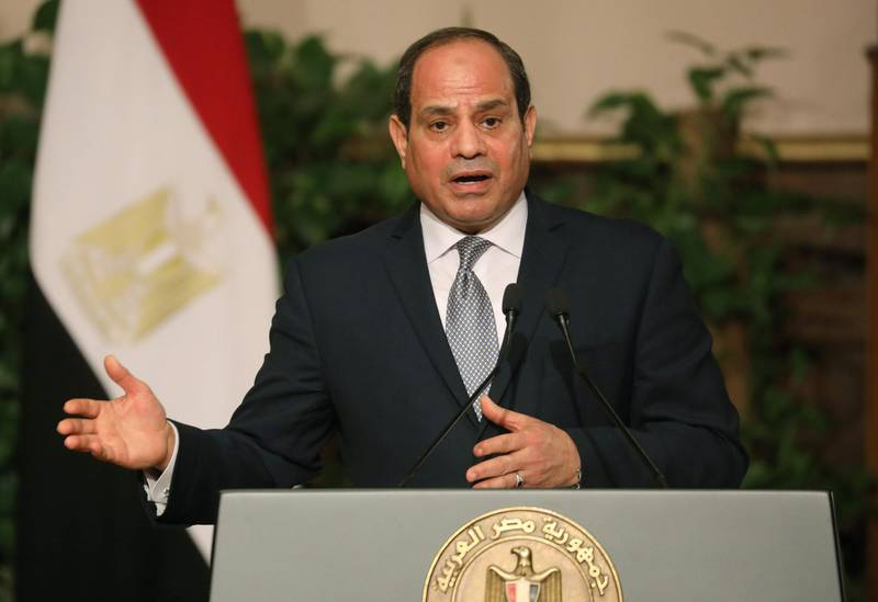 """Egyptian President Abdel Fattah al-Sisi speaks during a joint press conference with his French counterpart after their meeting in Cairo on January 28, 2019. French President Emmanuel Macron called for """"respect for individual freedoms"""" during his meeting with Sisi on his first official visit to Egypt. / AFP / Ludovic MARIN"""