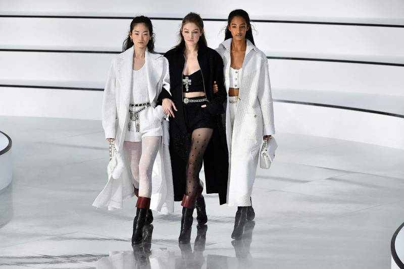 TOPSHOT - Models including US model Gigi Hadid (C) present creations for Chanel during the Women's Fall-Winter 2020-2021 Ready-to-Wear collection fashion show in Paris, on March 3, 2020.  / AFP / Christophe ARCHAMBAULT