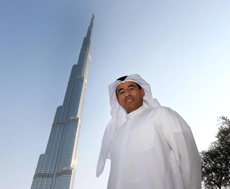 DUBAI, UNITED ARAB EMIRATES – Dec 30: Mohamed Ali Alabbar, Chairman of Emaar Properties PJSC at his office in Emaar Square in Dubai. Also seen in the photo Burj Dubai on his left. (Pawan Singh / The National) For Business. Story by Wayne Arnold *** Local Caption ***  PS3012- ALABBAR01.jpgBZ04JA P04 ALABAAR 01.jpg