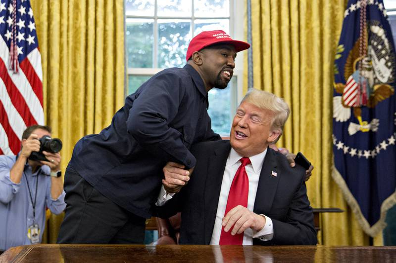 Rapper Kanye West, left, shakes hands with U.S. President Donald Trump during a meeting in the Oval Office of the White House in Washington, D.C., U.S., on Thursday, Oct. 11, 2018. West, a recording artist and prominent Trump supporter, is at the White House to have lunch with the president and to meet with presidential son-in-law and senior adviser Jared Kushner who has spearheaded the administrations efforts overhaul the criminal justice system. Photographer: Andrew Harrer/Bloomberg
