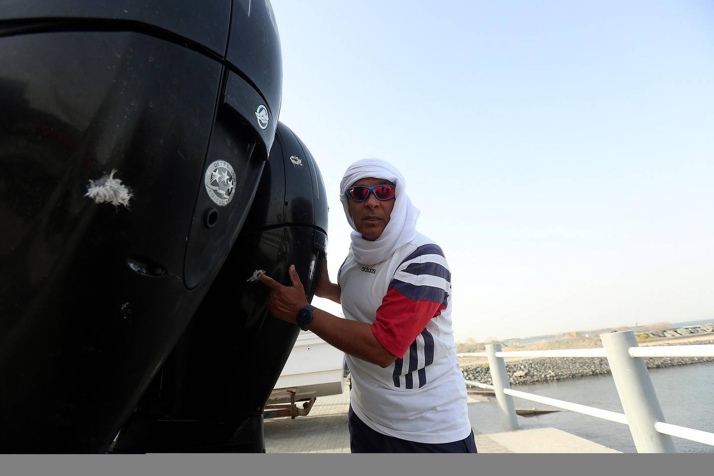 Fujairah, April 26, 2018: Yousef Baroun points out at the bullet shots fired by pirates during the interview at the fisherman port in Fujairah . Satish Kumar for the National / Story by Ruba Haza