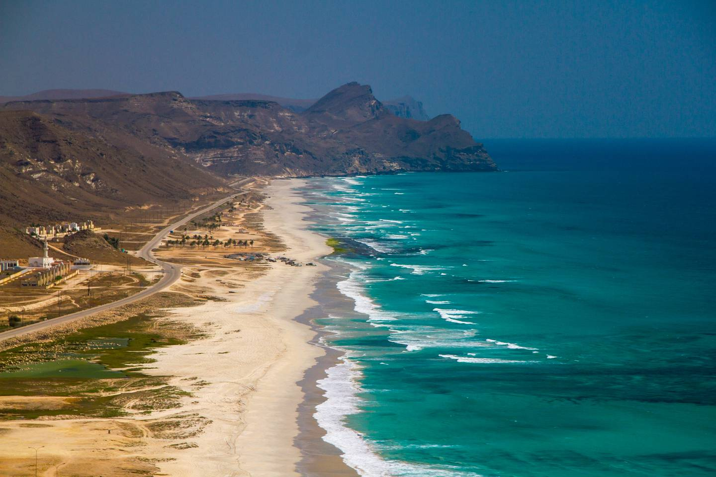 Aerial view of a white sand beach overlooking the Indian Ocean and mountains. Salalah, Oman. (Getty Images) *** Local Caption ***  ut23se-top10-oman02.jpg