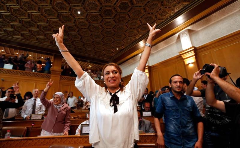 Souad Abderrahim, 54, flashes the V-sign after being elected as mayor of the Tunisian capital, Tunis, Tuesday, July 3, 2018. Souad Abderrahim of the Ennahdha party won the post in the second round of voting by the municipal council; the first time a woman holds the post. (AP Photo)