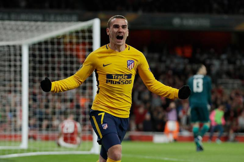 FILE - In this Thursday, April 26, 2018 file photo Atletico's Antoine Griezmann celebrates after scoring the first goal of his team during the Europa League semifinal first leg soccer match between Arsenal FC and Atletico Madrid at Emirates Stadium in London. (AP Photo/Matt Dunham, File)