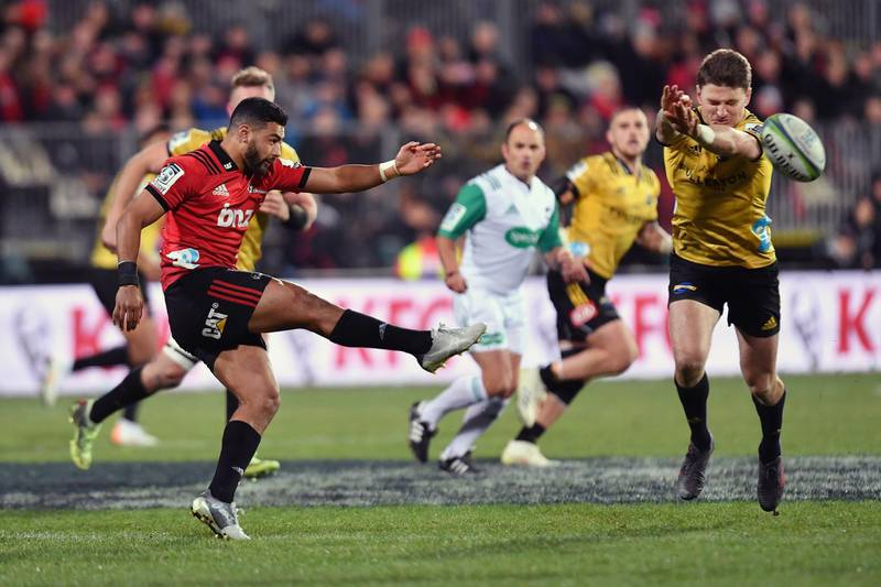 CHRISTCHURCH, NEW ZEALAND - JULY 28: Richie Mo'unga of the Crusaders kicks the ball during the Super Rugby Semi Final match between the Crusaders and the Hurricanes at AMI Stadium on July 28, 2018 in Christchurch, New Zealand.  (Photo by Kai Schwoerer/Getty Images)