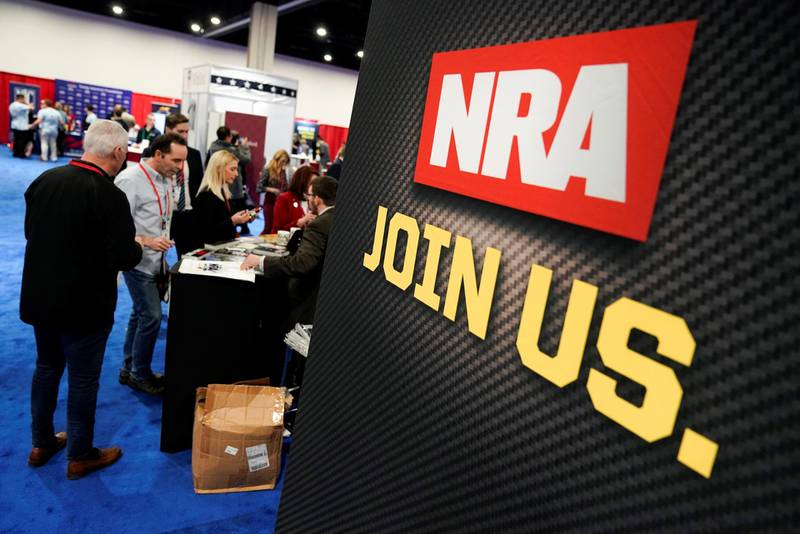 Attendees sign up at the National Rifle Association (NRA) booth at the Conservative Political Action Conference (CPAC) annual meeting at National Harbor in Oxon Hill, Maryland, U.S., February 27, 2020.      REUTERS/Joshua Roberts