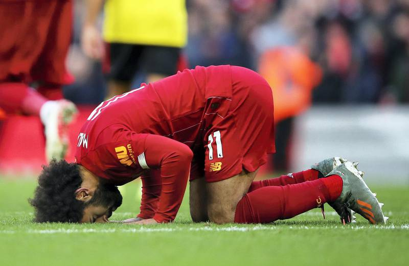 LIVERPOOL, ENGLAND - DECEMBER 14: Mohamed Salah of Liverpool celebrates after scoring his team's second goal during the Premier League match between Liverpool FC and Watford FC at Anfield on December 14, 2019 in Liverpool, United Kingdom. (Photo by Clive Brunskill/Getty Images)