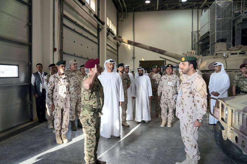AL DHAFRA REGION, ABU DHABI, UNITED ARAB EMIRATES - June 26, 2019: HH Sheikh Mohamed bin Zayed Al Nahyan, Crown Prince of Abu Dhabi and Deputy Supreme Commander of the UAE Armed Forces (back C) and HM King Abdullah II, King of Jordan (front C), attend the UAE and Jordan joint military drill, Titled 'Bonds of Strength', at Al Hamra Camp. Seen with HE Lt General Hamad Thani Al Romaithi, Chief of Staff UAE Armed Forces, HRH Hussein bin Abdullah, Crown Prince of Jordan, HH Sheikh Tahnoon bin Mohamed Al Nahyan, Ruler's Representative in Al Ain Region.  ( Mohamed Al Hammadi / Ministry of Presidential Affairs ) ---
