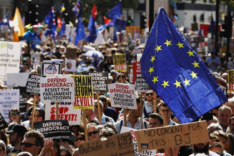 Demonstrators wave European Union (EU) flags and hold placards outside Downing Street during a protest against the proroguing of parliament, in London, U.K., on Saturday, Aug. 31, 2019. Prime Minister Boris Johnson askedQueen Elizabeth IIon Aug. 28 toproroguethe House of Commons, as the suspension is known in parliamentary jargon, from Sept. 12 until the Queen's Speech on Oct. 14. Photographer: Luke MacGregor/Bloomberg