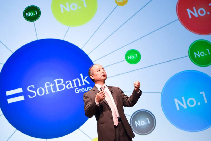Masayoshi Son, chairman and chief executive officer of SoftBank Group Corp., gestures while speaking during a news conference in Tokyo, Japan, on Wednesday, May 9, 2018. SoftBank Group Corp.'s fourth-quarter profit topped analysts' projections, thanks to Sprint Corp.'s first annual net income in more than a decade. The U.S. wireless subsidiary is planning to merge with rival T-Mobile US Inc. Photographer: Noriko Hayashi/Bloomberg