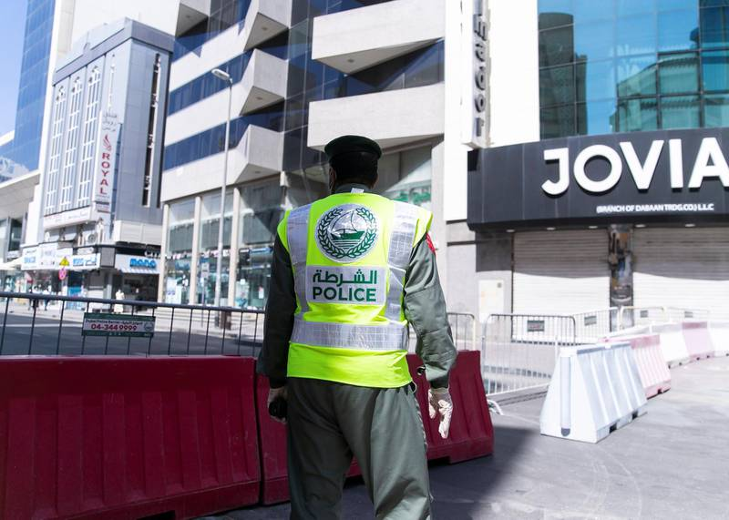 DUBAI, UNITED ARAB EMIRATES. 31 MARCH 2020. Dubai's Supreme Committee of Crisis and Disaster Management announced increased restrictions on movement in Al Ras area of Dubai for two weeks effective from today to facilitate intensified sterilisation procedures. @DubaiPoliceHQ appeals to the public to cooperate fully with the authorities and abide by all instructions to ensure the preventive measures implemented during the two-week period are a success. People who are not residents of Al Ras are prohibited from travelling to the area.RTA closed entrances leading to Al Ras area from three main roads and interchanges: Al Musalla, Al Khaleej, and Baniyas Streets. The plan also includes the closure of three stations on the metro green line: Al Ras, Palm Deira and Baniyas Square.(Photo: Reem Mohammed/The National)Reporter: NICK WEBSTERSection: COVID NA