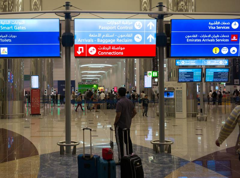 Airline travelers wait to clear immigration control at the Dubai International Airport in the United Arab Emirates on August 25, 2016. (Photo by Robert Nickelsberg/Getty Images) *** Local Caption ***  bz12ju-dubai-passengers.jpg