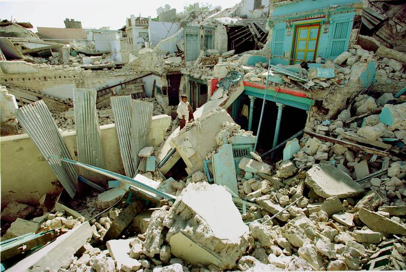 384915 05: A man stands in front of his home stunned by the destruction January 29, 2001 in the devastated village of Anjar, 40 k from Bhuj. Tens of thousands have died in this disaster so far, and an accurate count may never be known. (Photo Paula Bronstein/Liaison)