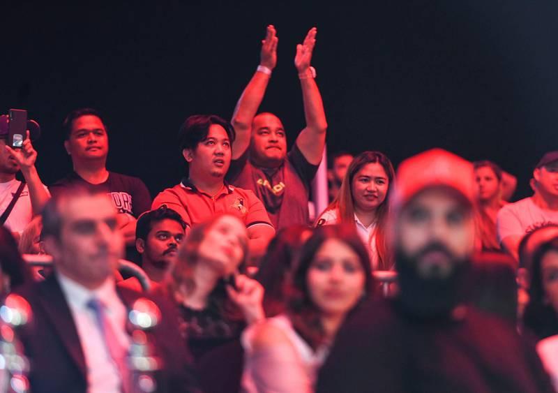 Abu Dhabi, United Arab Emirates - Fans cheering at the UAE Warriors MMA event at the Mubadala Arena, Zayed Sports City. Khushnum Bhandari for The National