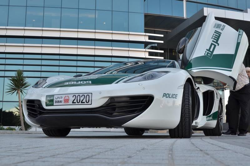 Dubai Police take receipt of a McLaren MP4-12C .Courtesy Dubai Police *** Local Caption ***  NMN_1154.JPG