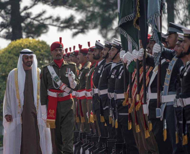 ISLAMABAD, PAKISTAN - January 06, 2019: HH Sheikh Mohamed bin Zayed Al Nahyan, Crown Prince of Abu Dhabi and Deputy Supreme Commander of the UAE Armed Forces (back L),  inspects honor guard during a reception at the Prime Minister's residence.  (  Mohammed Al Hammadi / Ministry of Presidential Affairs ) ---