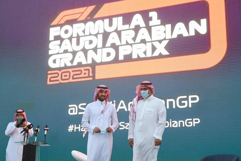 Saudi Sports Minister Prince Abdulaziz bin Turki (C) and Khalid al-Faisal, Chairman of the Saudi Automobile and Motorcycle Federation, are pictured on stage during a press conference to announce Saudi Arabian Grand Prix as part of the 2021 F1 calendar, in the Red Sea coastal city of Jeddah on November 5, 2020. Saudi Arabia said it will host a Formula One Grand Prix for the first time next year, with a night race in the Red Sea city of Jeddah. Saudi Arabia had been pencilled in for the 2021 season as part of a record 23-race Formula One programme, as the sport seeks to bounce back from a shortened 2020 season that has been disrupted by the coronavirus pandemic.  / AFP / Amer HILABI