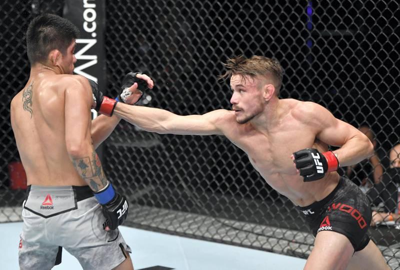 ABU DHABI, UNITED ARAB EMIRATES - JULY 26: (R-L) Nathaniel Wood of England punches John Castaneda in their bantamweight fight during the UFC Fight Night event inside Flash Forum on UFC Fight Island on July 26, 2020 in Yas Island, Abu Dhabi, United Arab Emirates. (Photo by Jeff Bottari/Zuffa LLC via Getty Images) *** Local Caption *** ABU DHABI, UNITED ARAB EMIRATES - JULY 26: (R-L) Nathaniel Wood of England punches John Castaneda in their bantamweight fight during the UFC Fight Night event inside Flash Forum on UFC Fight Island on July 26, 2020 in Yas Island, Abu Dhabi, United Arab Emirates. (Photo by Jeff Bottari/Zuffa LLC via Getty Images)