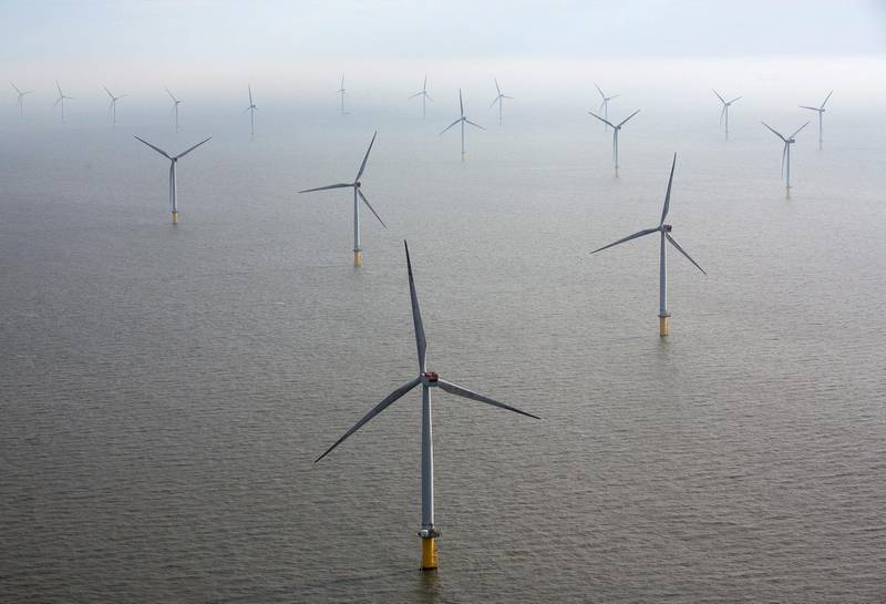 Wind turbines sit in the North Sea at the London Array offshore wind farm, a partnership between Dong Energy A/S, E.ON AG and Abu Dhabi-based Masdar, in the Thames Estuary, U.K., on Tuesday, Oct. 27, 2015. The London Array, east of London, has 175 Siemens turbines and a capacity of 630MW. Photographer: Simon Dawson/Bloomberg