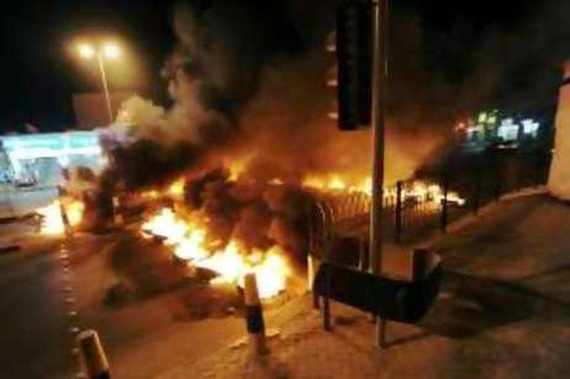 Tyres burn at a key intersection in Tubli village on the outskirts of capital Manama on Monday night