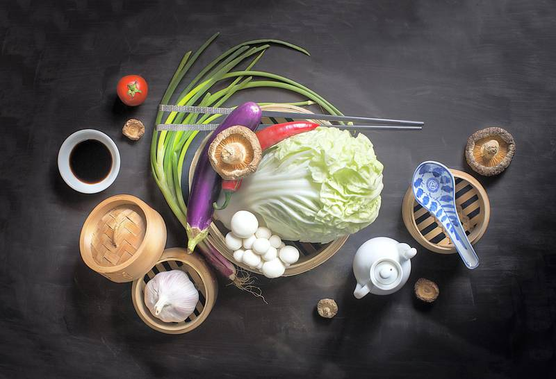 Flat lay Chinese vegan food and seasoning sauce still life with text space. Moody rustic background. Healthy eating lifestyle conceptual image.