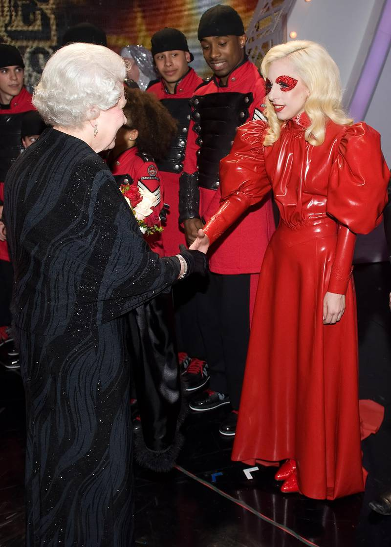 BLACKPOOL, UNITED KINGDOM - DECEMBER 7:  Queen Elizabeth II meets singer Lady Gaga following the Royal Variety Performance on December 7, 2009 in Blackpool, England  (Photo by Leon Neal/ WPA Pool /Getty Images)