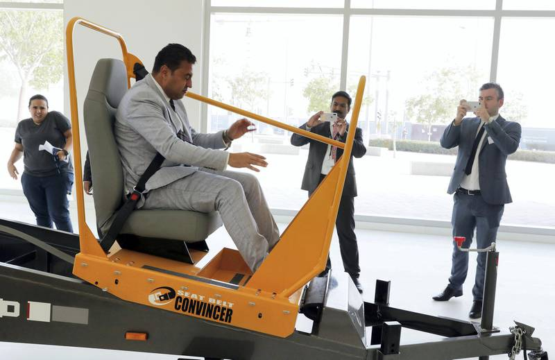 ABU DHABI , UNITED ARAB EMIRATES, September 18 , 2018 :- Ahmed Roshdy , Area General Manager , Facilities Management & Support Services , ADNH Compass taking the live demonstration of seat belt convincer after the Road Safety conference held at the New York University in Abu Dhabi. ( Pawan Singh / The National )  For News. Story by Patrick