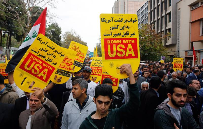 epa07971212 Iranians take part in an anti-US demonstration marking the 40th anniversary of US Embassy takeover, in front of the former US embassy in Tehran, Iran, 04 November 2019. According to media reports, thousands of protesters chanting 'Death to America' gathered at the former US embassy in Tehran to mark the 40th anniversary of the start of the Iran hostage crisis. Iranian students occupied the embassy on 04 November 1979 after the USA granted permission to the late Iranian Shah to be hospitalized in the United States. Over 50 US diplomats and guards were held hostage by students for 444 days. Iran and US tension over 2015 nuclear deal is going on.  EPA/ABEDIN TAHERKENAREH