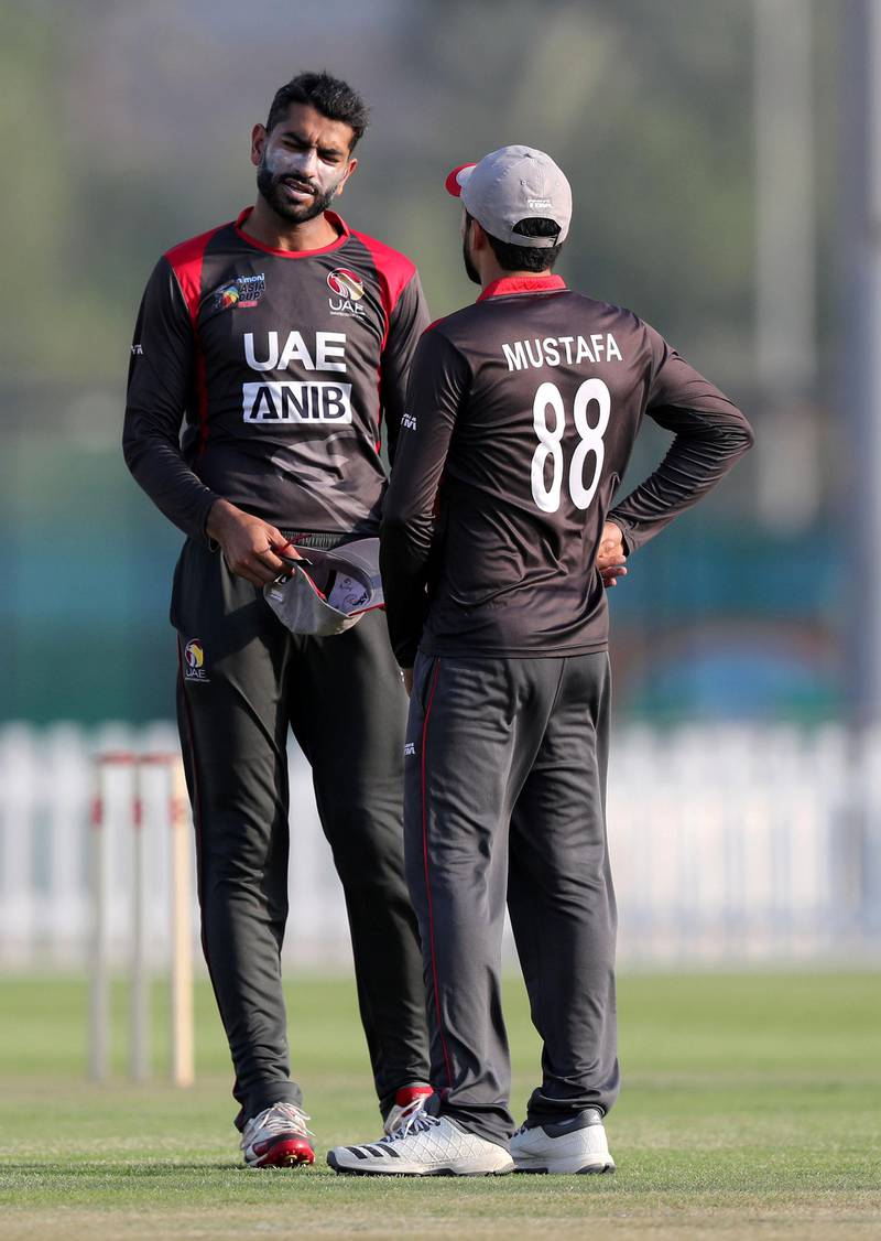 Abu Dhabi, United Arab Emirates - October 22, 2018: Ahmed Raza (L) and captain Rohan Mustafa of the UAE chat in the match between the UAE and Australia in a T20 international. Monday, October 22nd, 2018 at Zayed cricket stadium oval, Abu Dhabi. Chris Whiteoak / The National