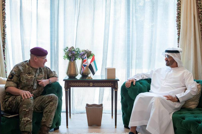 ABU DHABI, UNITED ARAB EMIRATES - June 25, 2019: HH Sheikh Mohamed bin Zayed Al Nahyan, Crown Prince of Abu Dhabi and Deputy Supreme Commander of the UAE Armed Forces (R), meets with Lieutenant General Sir John Lorimer, UK's Defence Senior Advisor to the Middle East (L).   ( Mohamed Al Hammadi / Ministry of Presidential Affairs ) ---