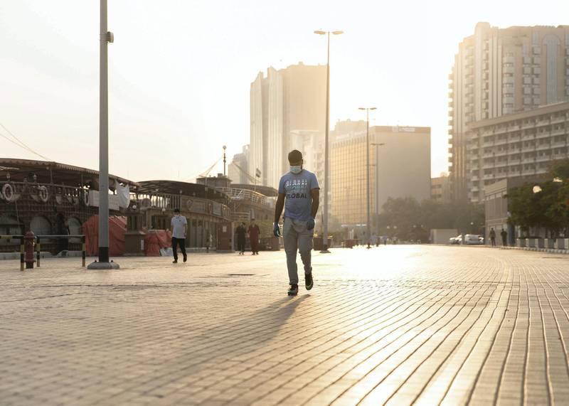 DUBAI, UNITED ARAB EMIRATES. 4 JUNE 2020. Peopl walk by Dubai Creek in  Deira.(Photo: Reem Mohammed/The National)Reporter:Section: