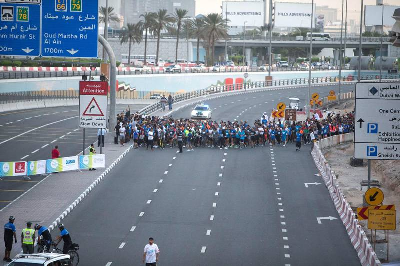 Dubai, United Arab Emirates - Participants starting to run at the Dubai 30x30 Run at Sheikh Zayed Road.  Leslie Pableo for The National