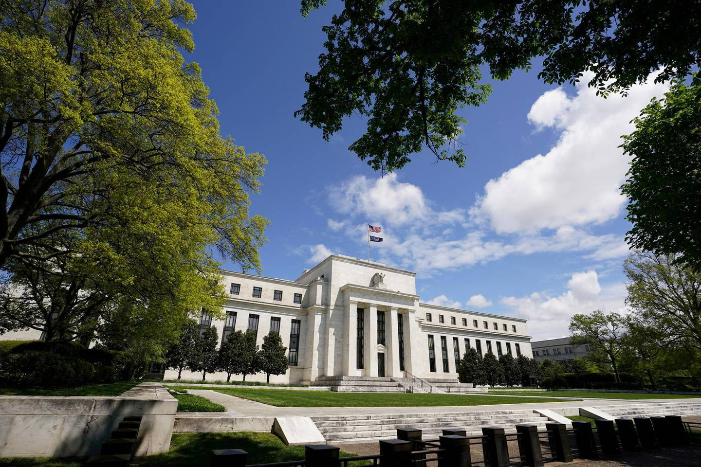 FILE PHOTO: The Federal Reserve building is set against a blue sky in Washington, U.S., May 1, 2020. REUTERS/Kevin Lamarque/File Photo