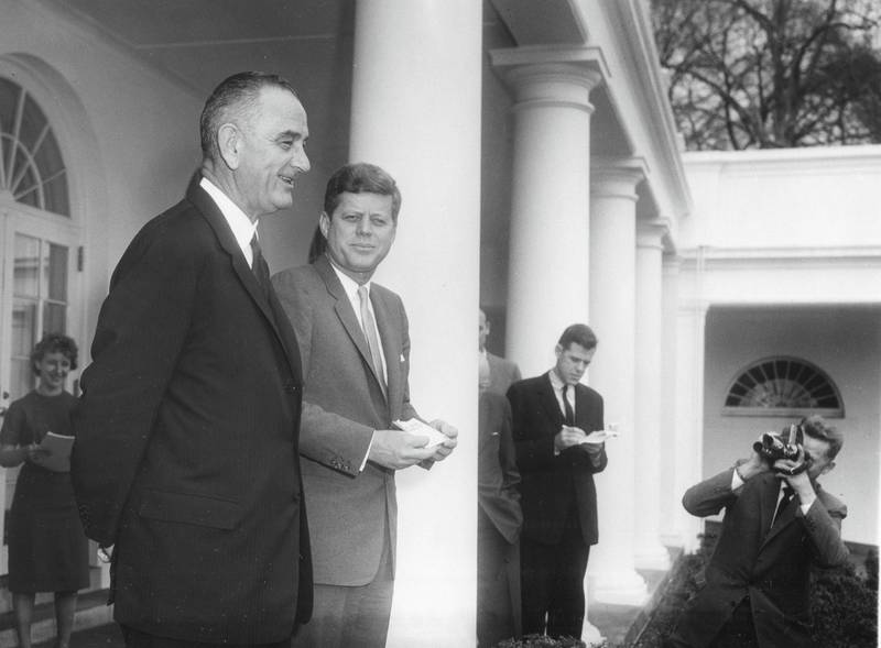 View of American politicians, Vice President Lyndon B Johnson (1908 - 1973) (left) and President John F Kennedy (1917 - 1963), as they meet with the press in the White House Rose Garden, Washington DC, March 6, 1961. President Kennedy had just signed Executive Order 10925 with required government contractors to treat all qualified employees equally 'without regard to their race, creed, color, or national origin.' (Photo by Abbie Rowe/PhotoQuest/Getty Images)