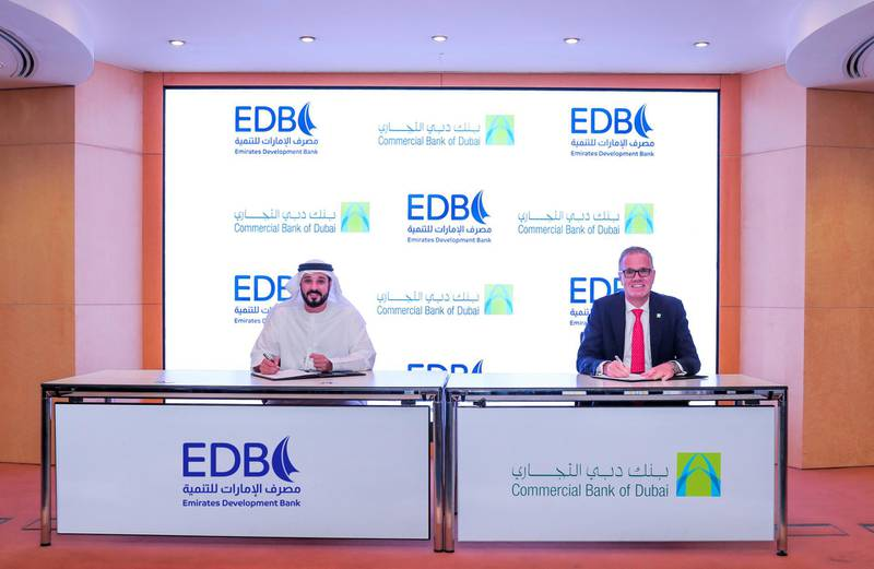 Ahmed Mohamed Al Naqbi, chief executive of Emirates Development Bank, signs a memorandum of understanding with Bernd van Linder, chief executive of Commercial Bank of Dubai, in Abu Dhabi on Wednesday. Courtesy: Emirates Development Bank