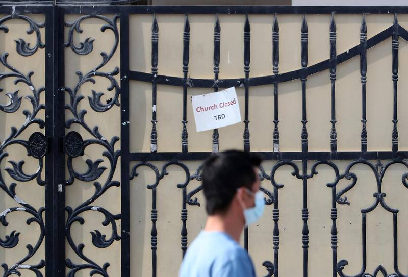 DUBAI, UNITED ARAB EMIRATES , December 25 – 2020 :- Church closed notice pasted on the gate of the Church on the Christmas day in Jebel Ali in Dubai. All the Church are closed because of Covid pandemic until further notice.  ( Pawan Singh / The National ) For News/Standalone/Online/Instagram