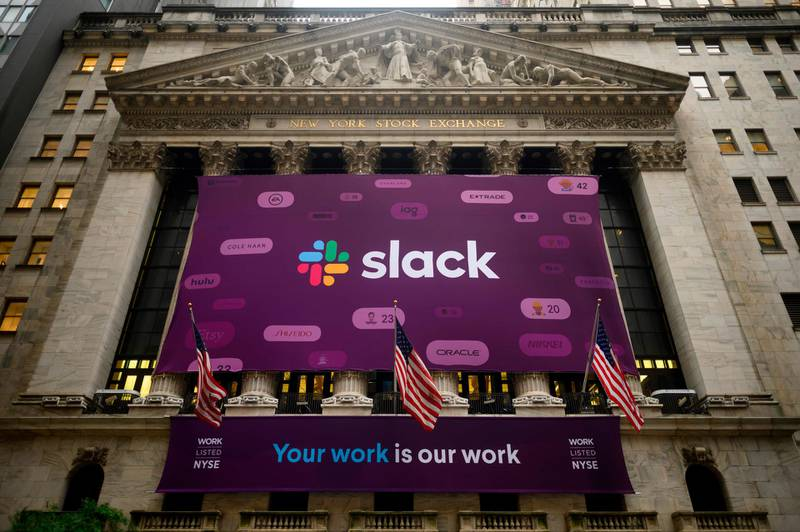 The logo of the Slack Technologies Inc. is seen outside the New York Stock Exchange (NYSE) after their company  public offering (IPO) on June 20, 2019 located at Wall Street in New York City. Software company Slack Technologies climbed on the New York Stock Exchange Thursday after debuting in a direct listing, in the latest sign of Wall Street's appetite for new technology entrants.Shares of the company, whose arrival was marked with a giant purple banner outside the NYSE, initially surged as high as $42 before pulling back somewhat and finishing at $38.62. The exchange had set a reference price of $26.  / AFP / Johannes EISELE