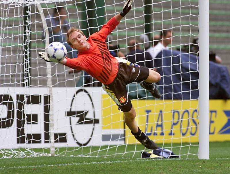 Scottish goalkeeper Jim Leighton dives to deflect a ball during a training session 22 June at Geoffroy Guichard stadium in Saint-Etienne, central France, on the eve of their 1998 Soccer World Cup Group A first round match against Morocco.   (ELECTRONIC IMAGE)   AFP PHOTO / AFP PHOTO / PATRICK KOVARIK