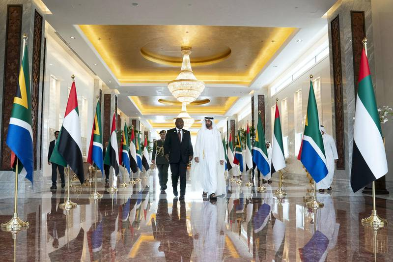 ABU DHABI, UNITED ARAB EMIRATES - July 13, 2018: HH Sheikh Mohamed bin Zayed Al Nahyan Crown Prince of Abu Dhabi Deputy Supreme Commander of the UAE Armed Forces (R), receives HE Cyril Ramaphosa, President of South Africa (L), at the Presidential Airport.   ( Mohamed Al Hammadi / Crown Prince Court - Abu Dhabi ) ---
