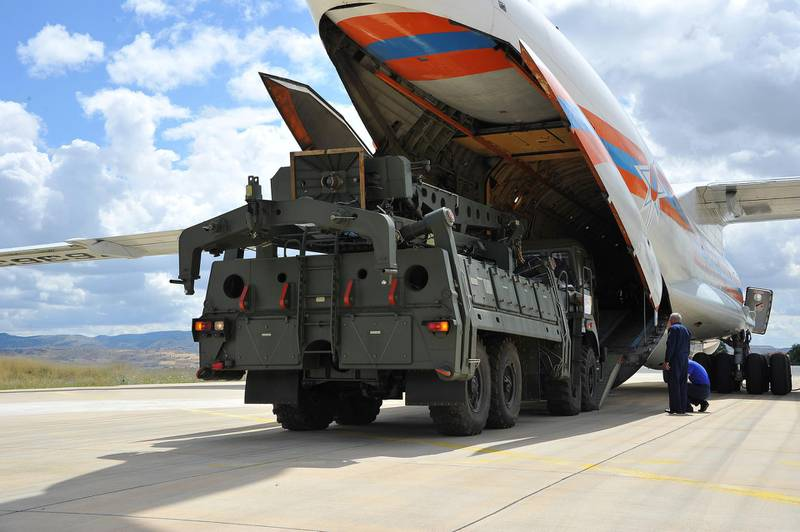 First parts of a Russian S-400 missile defense system are unloaded from a Russian plane at Murted Airport, known as Akinci Air Base, near Ankara, Turkey, July 12, 2019. Turkish Military/Turkish Defence Ministry/Handout via REUTERS ATTENTION EDITORS - THIS PICTURE WAS PROVIDED BY A THIRD PARTY. NO RESALES. NO ARCHIVE
