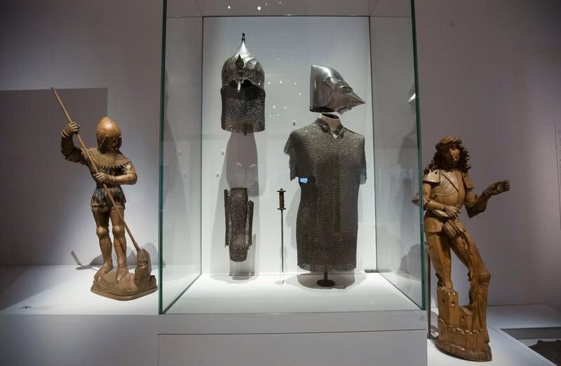 Abu Dhabi, United Arab Emirates-Helmets and shields at Furusiyya The Art of Chivalry between East and West, which draws links between knightly traditions of Europe and the Middle East at Louvre Abu Dhabi.  Leslie Pableo for The National