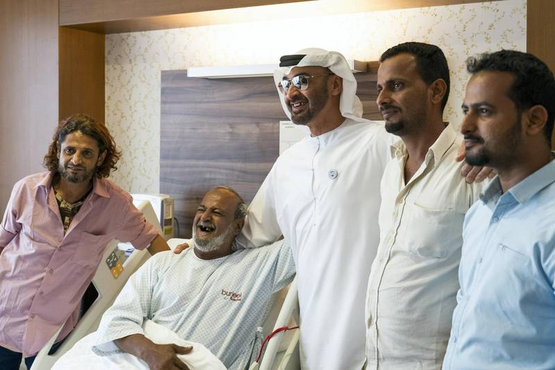 ABU DHABI, UNITED ARAB EMIRATES -  March 11, 2018: HH Sheikh Mohamed bin Zayed Al Nahyan, Crown Prince of Abu Dhabi and Deputy Supreme Commander of the UAE Armed Forces (3rd L), visits Fadel Mahmoud Saleh (2nd L), who is in Abu Dhabi receiving medical assistance at Burjeel Hospital.  ( Ryan Carter for the Crown Prince Court - Abu Dhabi ) ---