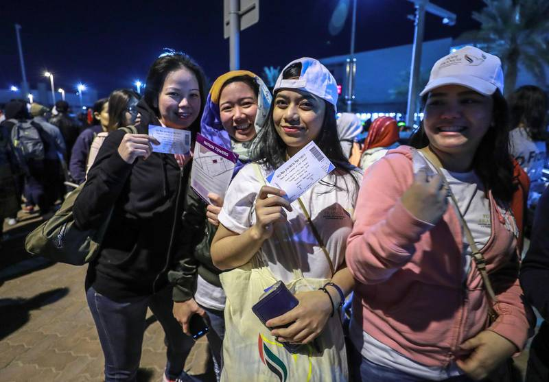 Abu Dhabi, U.A.E., February 5, 2019.   Worshipers heading onto buses at Nation Towers before they're transported to the mass. --  Ticket holders patiently wait for the bus to the mass.Victor Besa/The NationalSection:  NAReporter:
