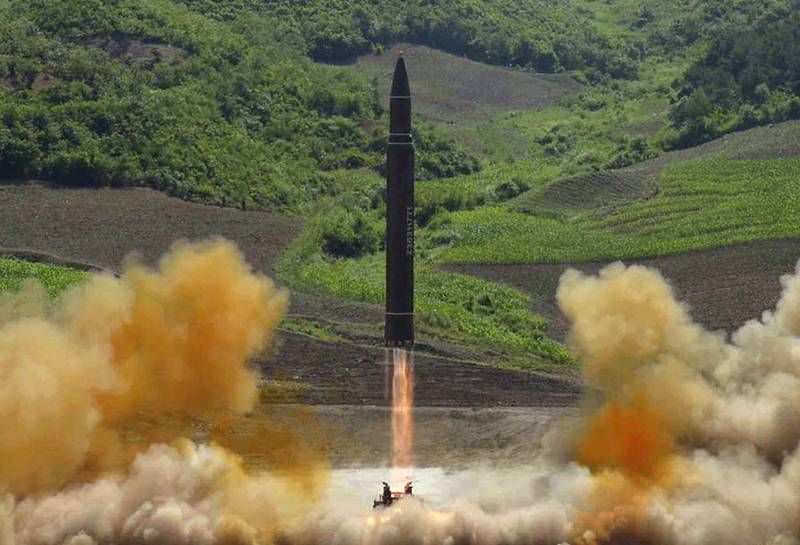"""FILE - This file photo distributed by the North Korean government shows what was said to be the launch of a Hwasong-14 intercontinental ballistic missile, ICBM, in North Korea's northwest, Tuesday, July 4, 2017. Donald Trump's threat to unleash """"fire and fury"""" on North Korea might have been written by Pyongyang's propaganda mavens, so perfectly does it fit the North's cherished claim that it is a victim of American aggression. (Korean Central News Agency/Korea News Service via AP, File)"""