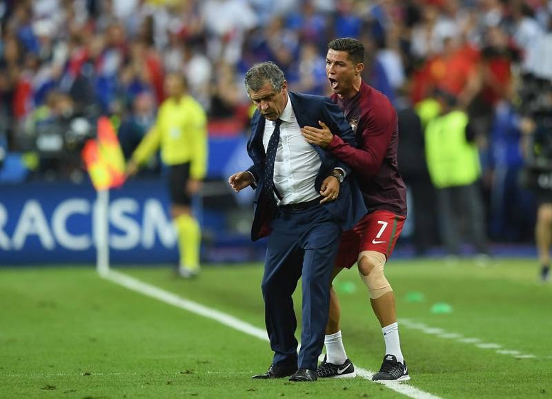 PARIS, FRANCE - JULY 10:  Manager Fernando Santos and Cristiano Ronaldo of Portugal celebrate winning at the final whistle during the UEFA EURO 2016 Final match between Portugal and France at Stade de France on July 10, 2016 in Paris, France.  (Photo by Matthias Hangst/Getty Images)