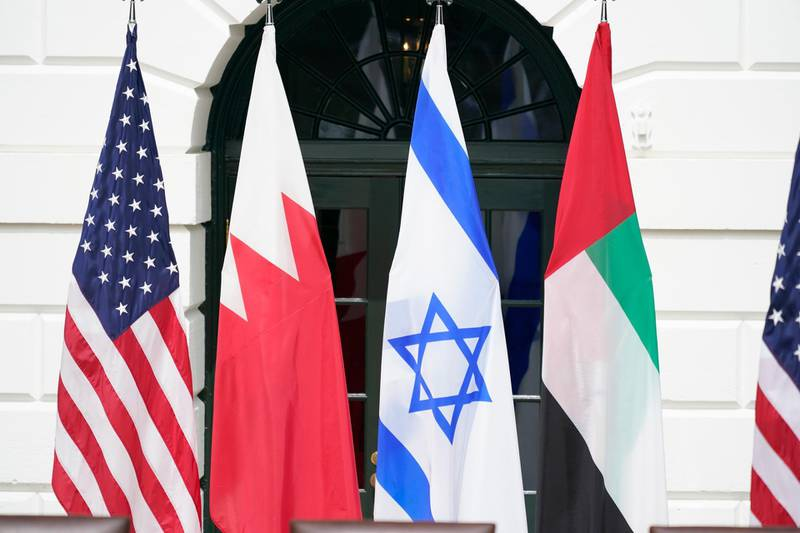 epa08671211 Flags of the United States, Bahrain, Israel and the United Arab Emirates during a signing ceremony of the 'Abraham Accords' on the South Lawn of the White House in Washington, DC, USA, 15 September 2020.  EPA/Chris Kleponis / POOL