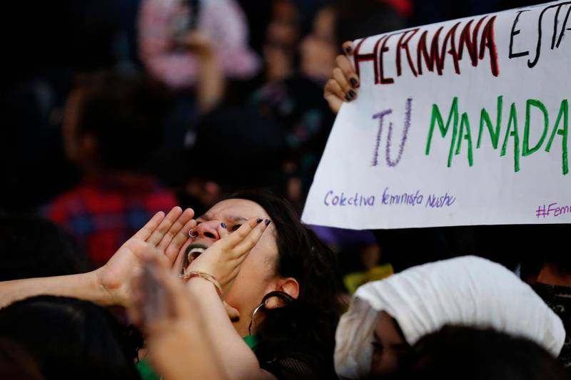 A woman shouts out during a protest march demanding justice and for their safety, during a protest sparked by a string of alleged sexual attacks by police officers, in Mexico City, Friday, Aug. 16, 2019. On Friday, hundreds of women demonstrated largely peacefully in downtown Mexico City with pink spray paint and smoke. But some protesters trashed the nearby bus station and a police station. This week, an auxiliary policeman was held for trial on charges he raped a young female employee at a city museum. (AP Photo/Marco Ugarte)