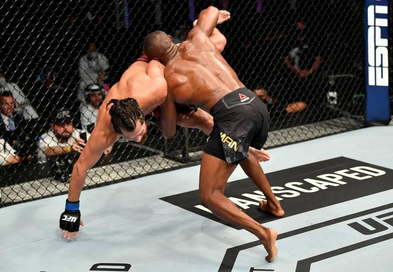 ABU DHABI, UNITED ARAB EMIRATES - JULY 12: (R-L) Kamaru Usman of Nigeria takes down Jorge Masvidal in their UFC welterweight championship fight during the UFC 251 event at Flash Forum on UFC Fight Island on July 12, 2020 on Yas Island, Abu Dhabi, United Arab Emirates. (Photo by Jeff Bottari/Zuffa LLC) *** Local Caption *** ABU DHABI, UNITED ARAB EMIRATES - JULY 12: (R-L) Kamaru Usman of Nigeria takes down Jorge Masvidal in their UFC welterweight championship fight during the UFC 251 event at Flash Forum on UFC Fight Island on July 12, 2020 on Yas Island, Abu Dhabi, United Arab Emirates. (Photo by Jeff Bottari/Zuffa LLC)